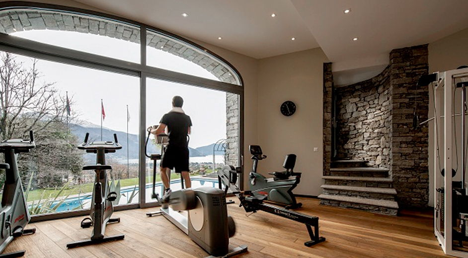 Luxury hotel with outdoor pool and scenic lake views in ticino for Luxury home gym